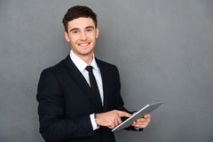 Businessman with digital tablet. Royalty Free Stock Photos