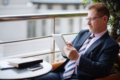 Businessman with digital tablet Royalty Free Stock Images