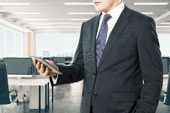 Businessman with digital tablet in modern open space loft office stock images