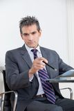 Businessman With Digital Tablet In Office Royalty Free Stock Photography