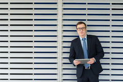 Businessman with a digital tablet Royalty Free Stock Image
