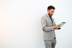 Businessman with digital tablet is standing near copy space for your advertising text message royalty free stock photo