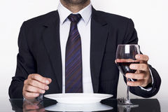 Businessman dining. With a glass of red wine Stock Images