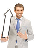 Businessman with direction arrow sign Stock Photos