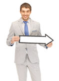 Businessman with direction arrow sign Royalty Free Stock Images