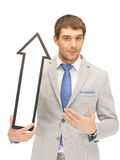 Businessman with direction arrow sign Stock Photography