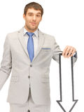 Businessman with direction arrow sign Royalty Free Stock Photo