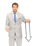 Businessman with direction arrow sign Royalty Free Stock Photos