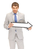 Businessman with direction arrow sign Stock Photo