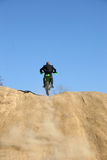 Businessman on Dirt Bike Stock Image