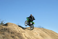 Businessman on Dirt Bike Royalty Free Stock Photos
