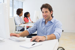 Businessman with disability works hard Stock Photography