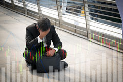 Businessman is disappointed from losing in stock exchange, econo Stock Photos