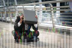 Businessman is disappointed from losing in stock exchange, econo Stock Images