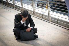 Businessman is disappointed from losing in stock exchange, econo Royalty Free Stock Photo