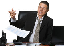 The businessman discontentedly throws report Stock Image