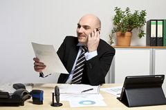 Businessman discusses on mobile phone sales development Stock Photo