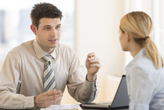Businessman Discussing With Colleague In Meeting At Office Stock Photo