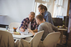 Businessman discussing with colleague during meeting royalty free stock photos