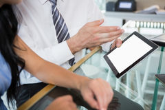 Businessman discussing with colleague over digital tablet Royalty Free Stock Image