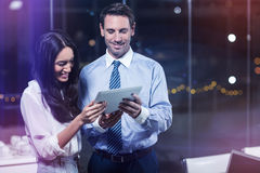 Businessman discussing with colleague over digital tablet. In office Stock Photo