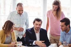 Businessman discussing with coworkers Stock Image
