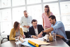Businessman discussing with coworkers in meeting Royalty Free Stock Photos