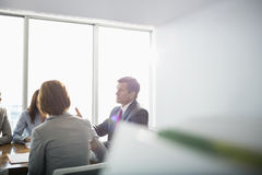 Businessman discussing with female team in conference room Royalty Free Stock Photography