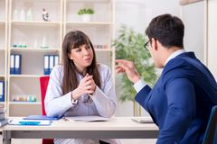 The businessman discussing health issues with doctor. Businessman discussing health issues with doctor stock photography