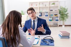 The businessman discussing health issues with doctor. Businessman discussing health issues with doctor stock photos