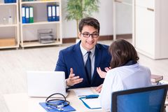 The businessman discussing health issues with doctor. Businessman discussing health issues with doctor royalty free stock photos