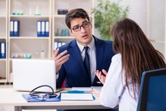 The businessman discussing health issues with doctor royalty free stock image