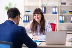The businessman discussing health issues with doctor. Businessman discussing health issues with doctor royalty free stock photo