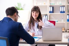 The businessman discussing health issues with doctor. Businessman discussing health issues with doctor stock photo