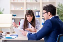 The businessman discussing health issues with doctor. Businessman discussing health issues with doctor royalty free stock image