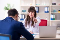 The businessman discussing health issues with doctor. Businessman discussing health issues with doctor stock images