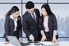Businessman discussing with his partners Stock Photo