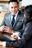 Businessman discussing about new project with client Royalty Free Stock Photo
