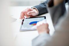 Businessman discussing a pie graph Stock Photos