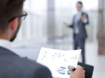 Businessman discussing standing in the office. Photo with copy space royalty free stock image
