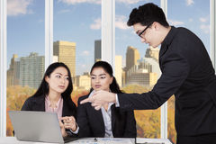 Businessman discussing with two businesswomen Stock Images