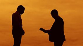 Businessman discussion sunset silhouette sunlight standing clipboard concept. two businessman men swearing conflict. Outdoors fight looking slow motion video stock footage