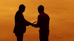 Businessman discussion sunset silhouette sunlight standing clipboard concept. two businessman men are in talks looking. Outdoors slow motion video stock video footage
