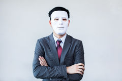 Businessman in disguise mask in white background Stock Image