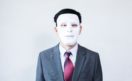 Businessman in disguise mask in white background Stock Photos