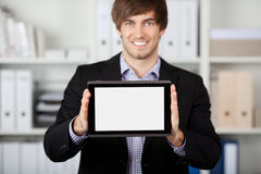 Businessman Displaying Digital Tablet In Office Stock Photo