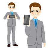Businessman Displaying Smartphone. Young attractive businessman displaying smartphone on horizontal and vertical position Royalty Free Stock Images