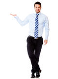 Businessman displaying something Stock Photography