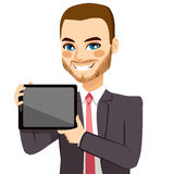 Businessman Displaying Tablet. Attractive businessman displaying tablet on horizontal position Stock Image