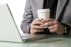 Businessman with a disposable coffee cup Royalty Free Stock Photo